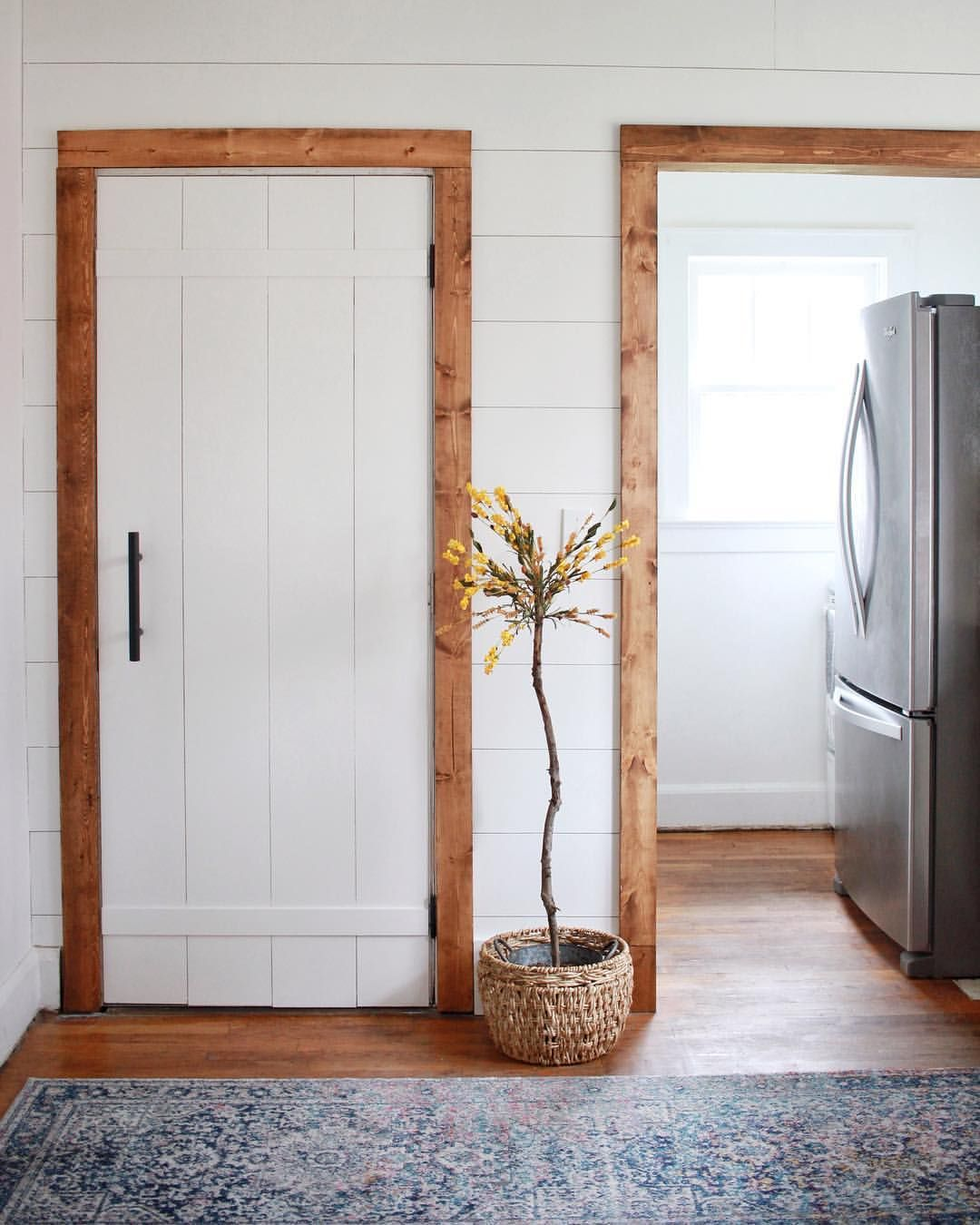 Shiplap Wall with Warm Wood Door Frames  Wood door frame, Ship