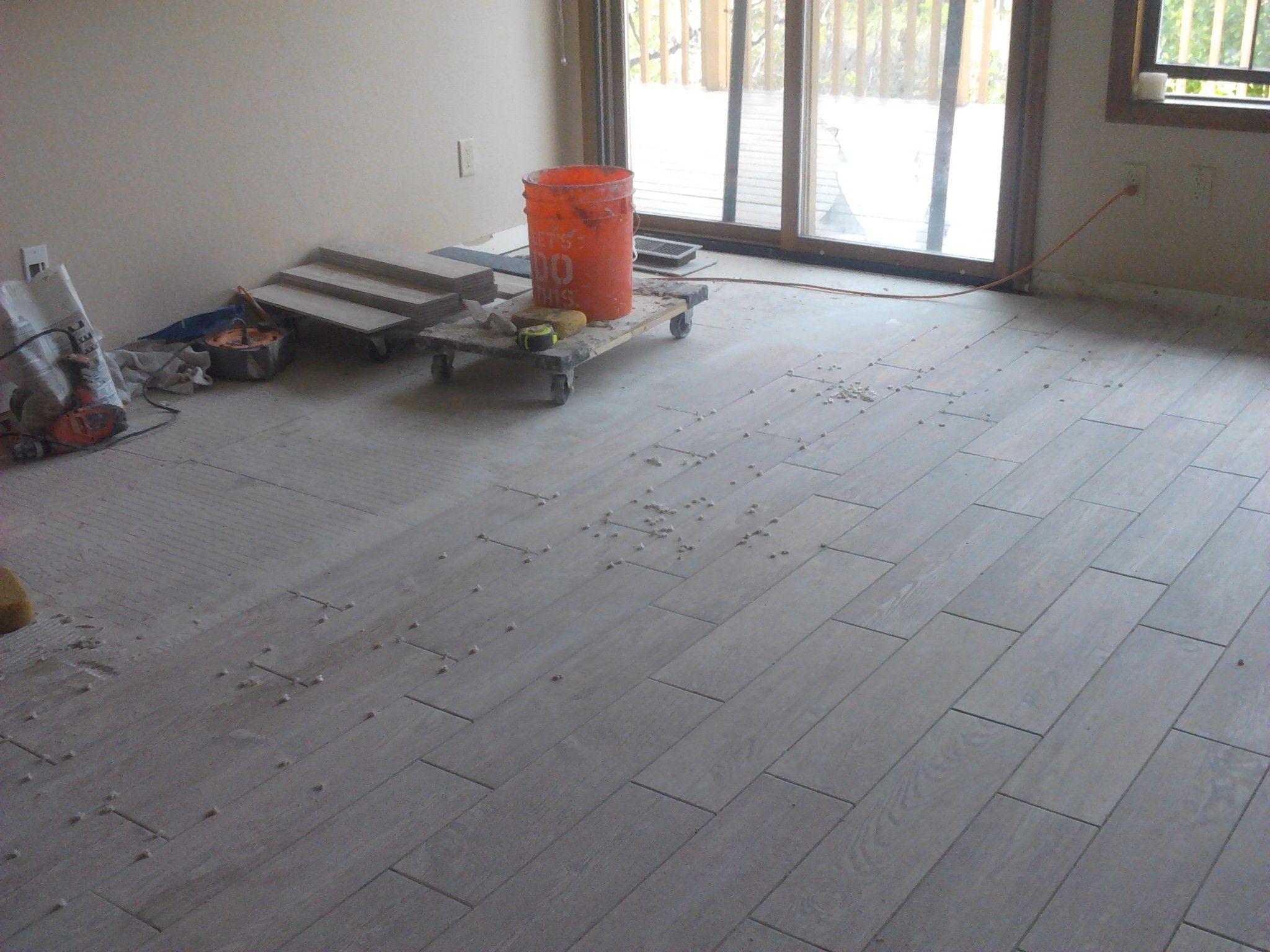 Pin By Avm Home Solutions On Floor Tile Porcelain Wood Grained Finish Light Cream Tile Floor Master Bedding Porcelain Tile