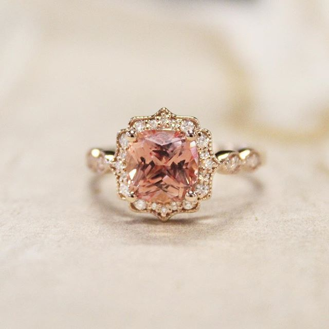 Just Peachy Link In Bio To Shop This Style Cadenza Halo Diamond Ring Custom Set With A Peach Cushion Sapp Pretty Rings Beautiful Jewelry Diamond Engagement