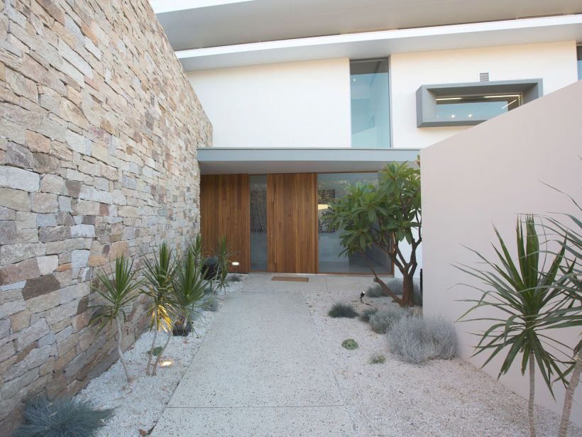 Eco outdoor alpine drystone blade wall creates privacy for home front entrance