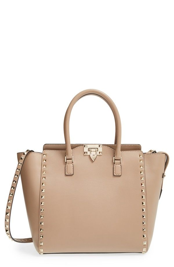 Free shipping and returns on Valentino 'Rockstud' Double Handle Tote at Nordstrom.com. Just the right size for carrying yet not too small to accommodate your essentials, the Rockstud tote will carry you through the seasons in polished style. The dual rolled top handles and studded, optional strap lend even more versatility to a tote that can add a fashionable focal point to casual wear, or perfectly complement dressier ensembles.