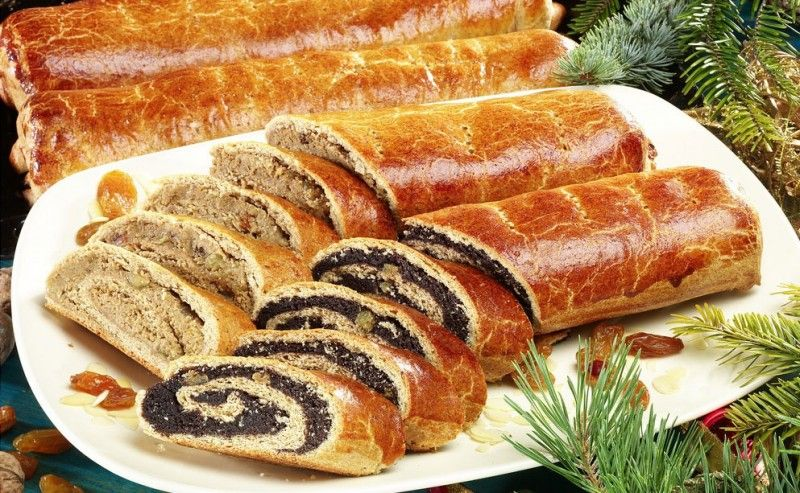 Bejgli (say: bey-glee) fine pastry rolls filled with poppy seed or walnut. Traditional Christmas dessert in Hungary.