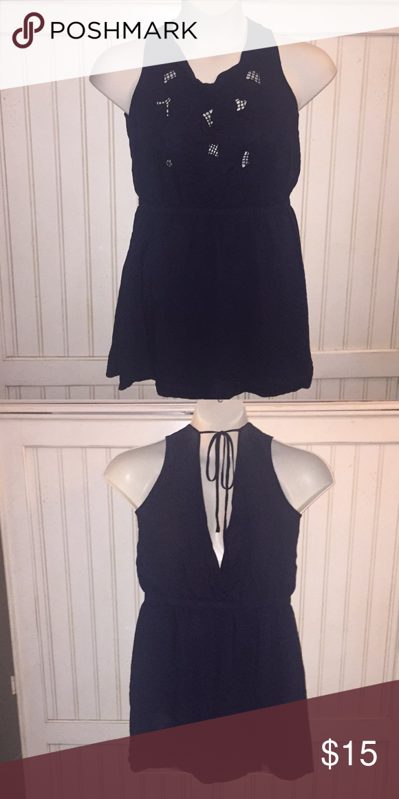 Short navy blue dress Short navy blue dress with peek a boo bodice and tie back. Elastic to define waist. Lined inside. Made by Forever 21. Size L. 100% rayon. Hand wash, line dry. Very good condition. Smoke free home. Forever 21 Dresses #navyblueshortdress