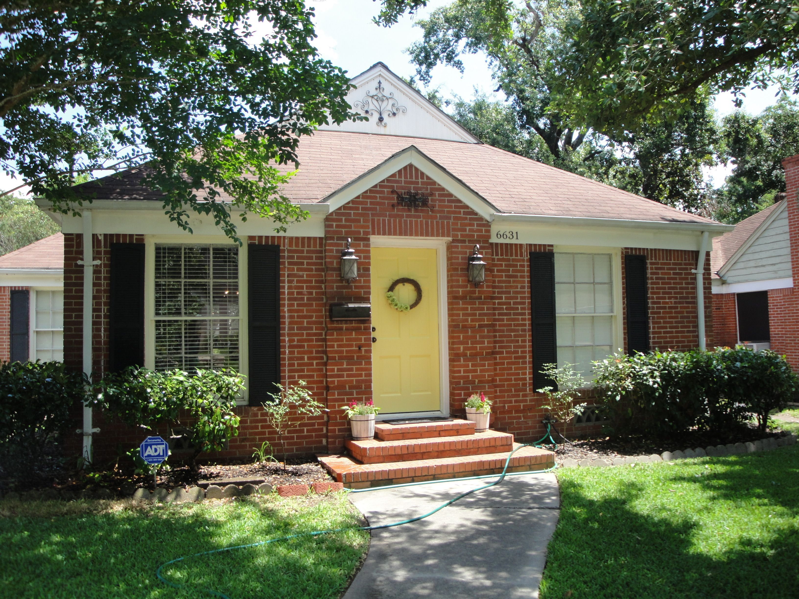 Red Brick Ranch House With Navy Shutters And Front Door Google Search Brick House Front Door Colors Yellow Front Doors Brick Exterior House