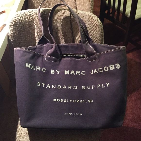 Marc by Marc Jacobs tote! Beautiful dark blue tote. There are some signs of wear on the inside (see second picture) but it generally looks really good. This bag is sturdy and has a shape to it. Marc by Marc Jacobs Bags Totes