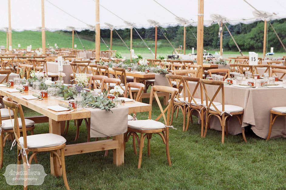 Overview Of Rustic Family Style Farmhouse Harvest Tables With Linen Table  Runners And Simple Natural Flowers