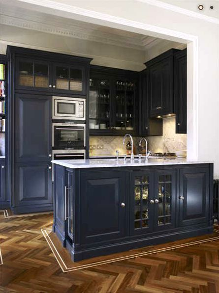 Blue Kitchen Cabinets With Herringbone Wood Flooring