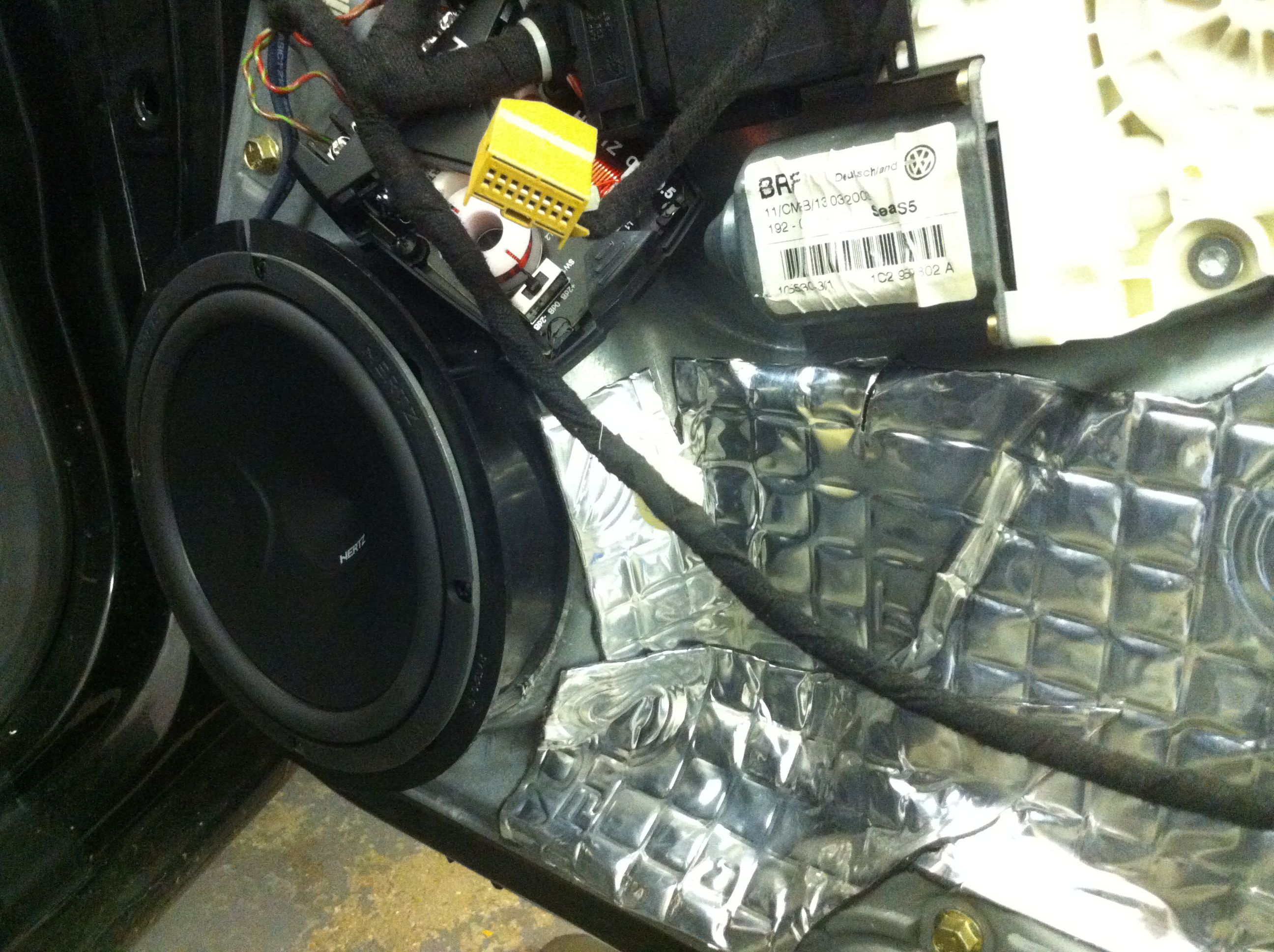 Hertz audio speakers with soundproofing installed in a seat leon cupra r