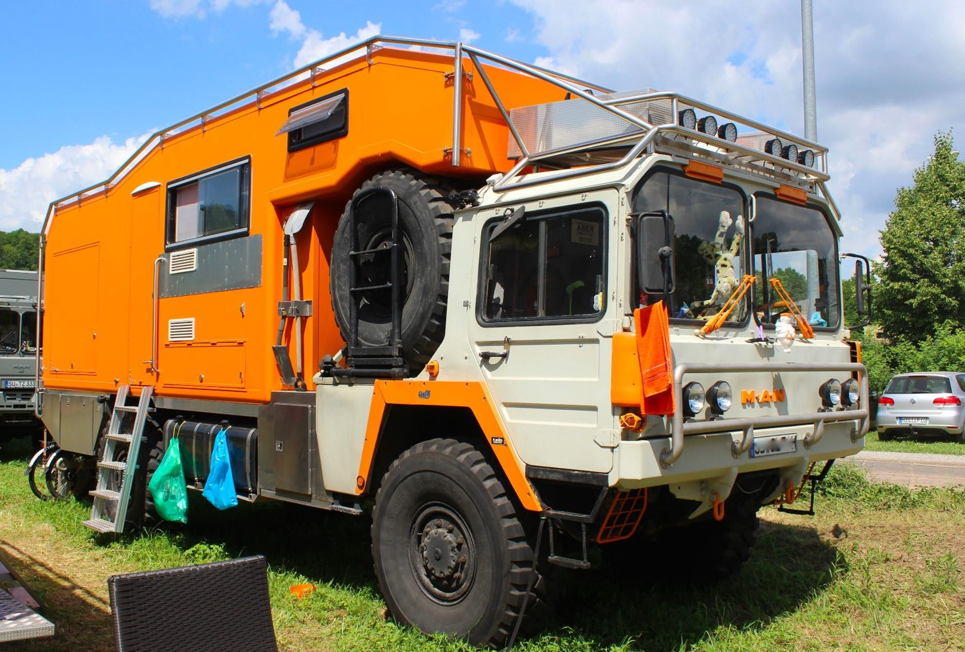 In Photos Adrift In A Sea Of Monstrous Camping Machines At The World S Biggest Cross Country Vehicle Expo Big Cross Camping Recreational Vehicles