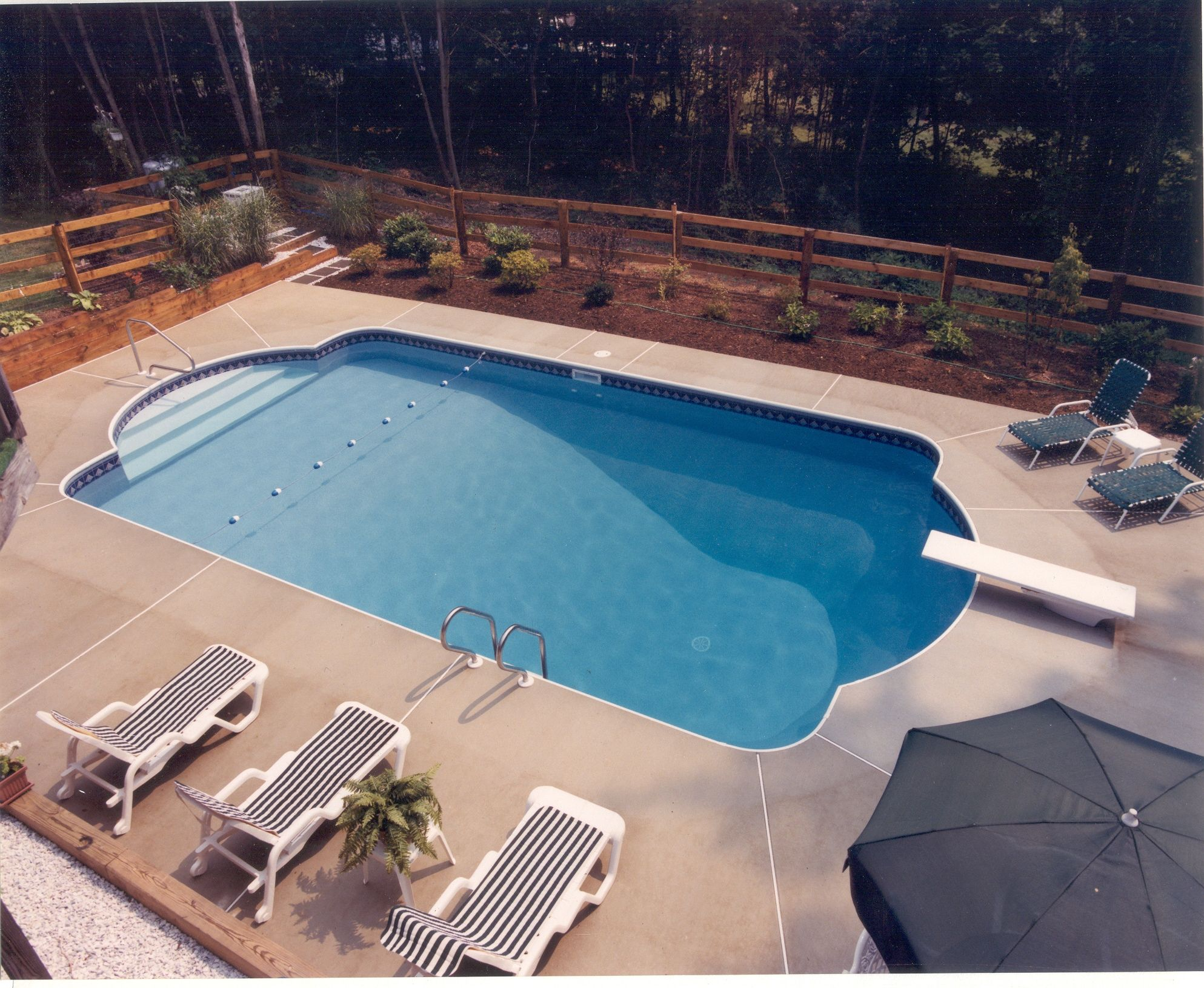 this pool is in the roman end style, with a brushed concrete deck