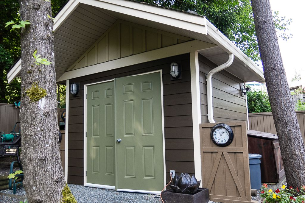 Garden Shed Painted In Chocolate Brown With Cream And Sage Green