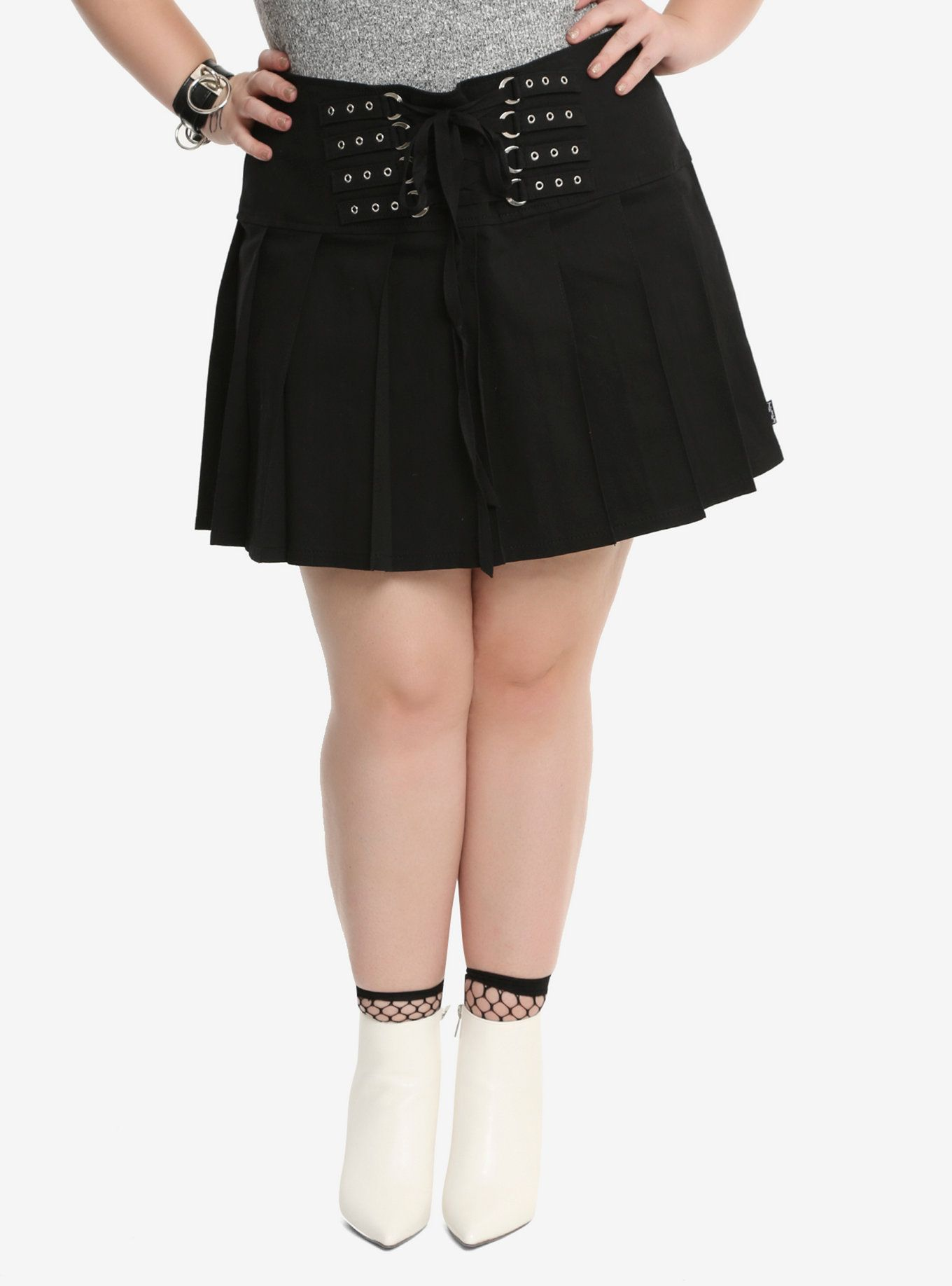 ef521739095 Everyone needs a black skirt in their wardrobe. Make yours cooler than  everyone else s when you wear this one from Tripp! The black pleated skirt  has strap ...