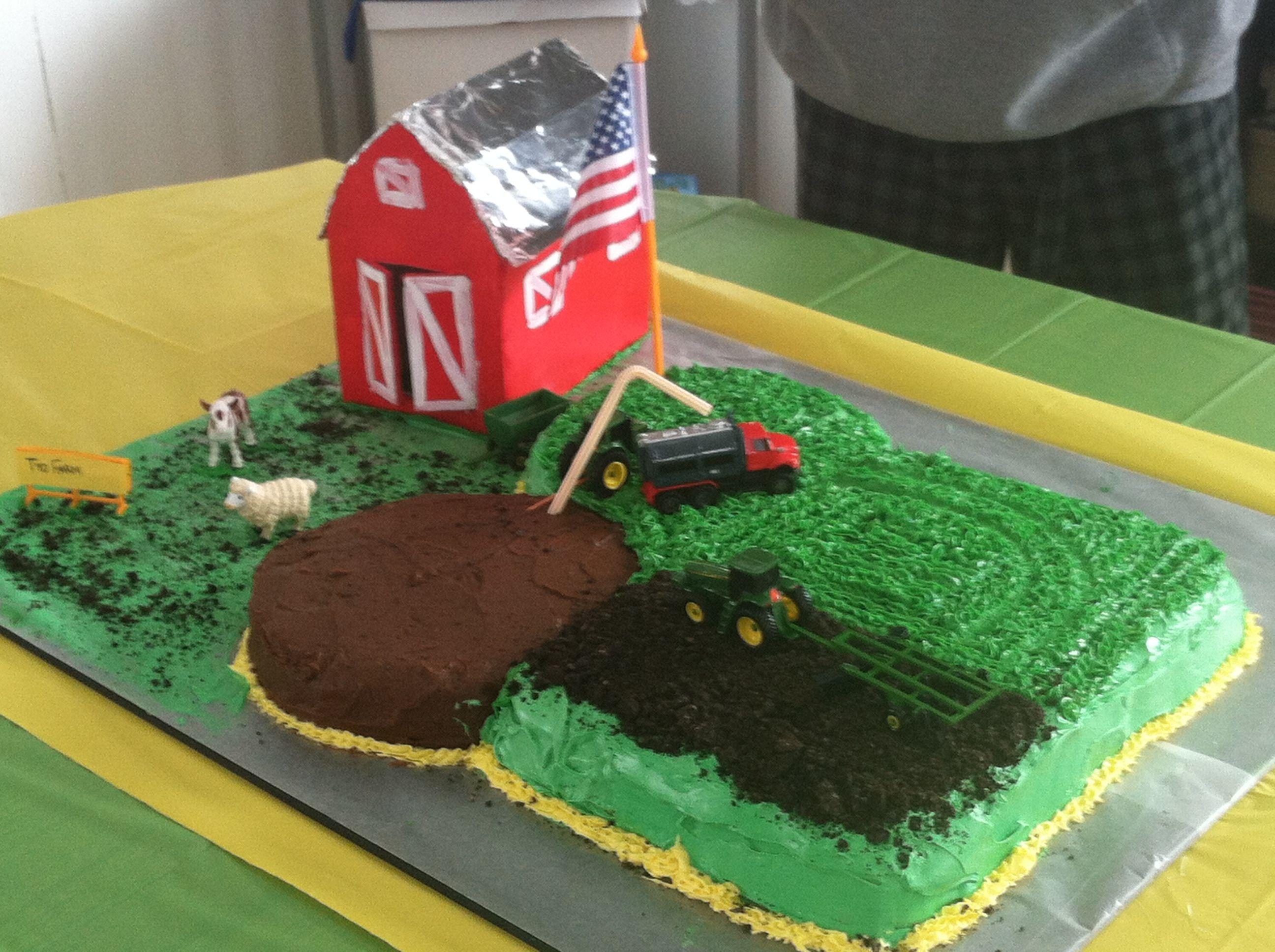 John Deere Farm cake with manure pit tanker hauling it to field