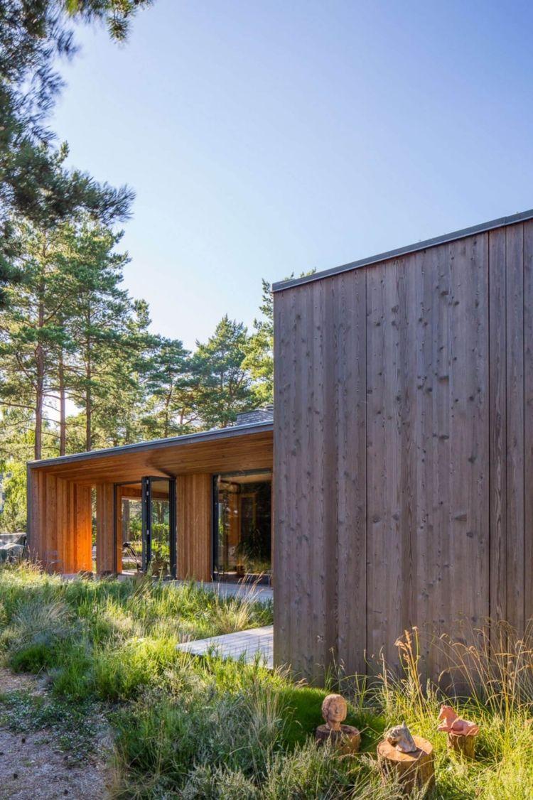 Maison Ossature Bois Suede bardage en bois extérieur et intérieur d'une superbe villa