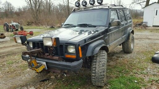 Our 98 Cherokee Sport With The Snow Plow Rig And Light Bar