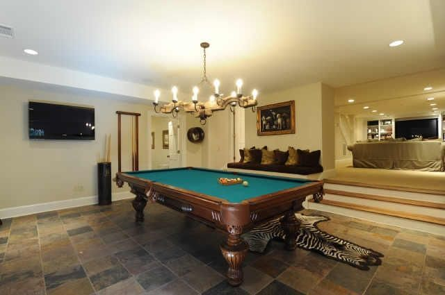 Photo of Game or recreational room with separate family room or home theater. [From the r…