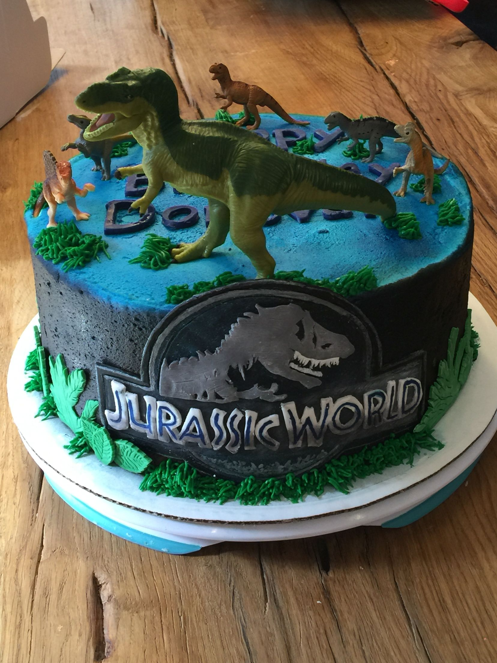 Jurassic World cake. Logo \u0026 greenery all done in modeling