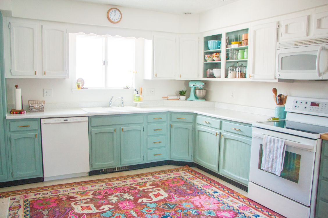 A few weeks ago, I posted the full reveal of our DIY kitchen update. (If you missed it, check it out here!) With $200 and about a week of hard work, our kitchen was transformed from this… int…