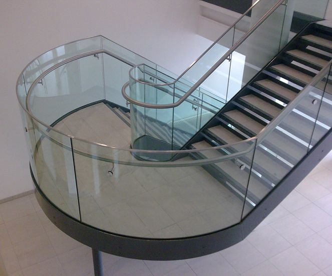 Feature Stair With Curved Glass Balustrade And Stainless Steel | Curved Glass Stair Railing | Residential Glass | Commercial Glass | Band Glass | Walnut | Frameless Glass
