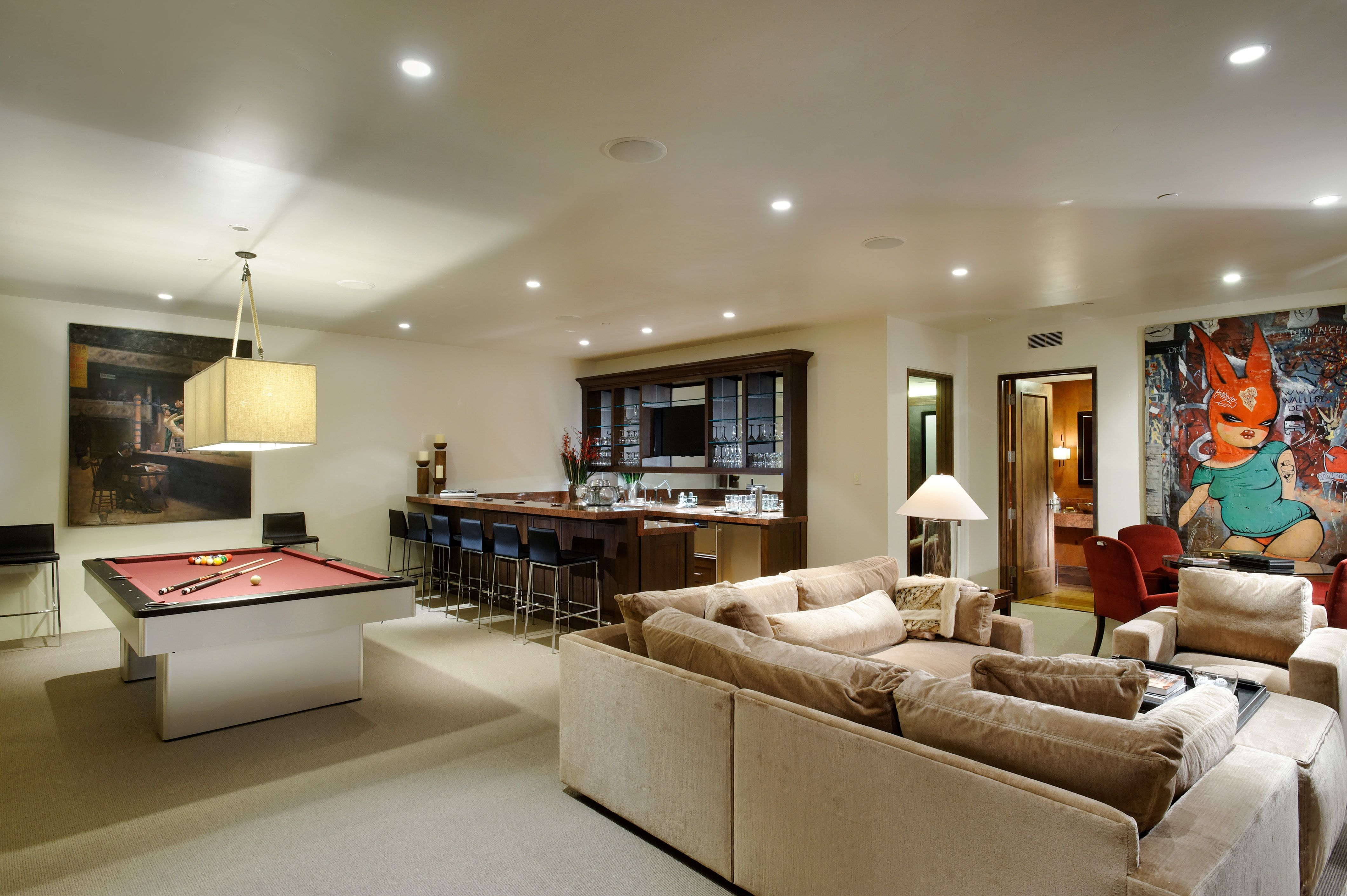 Game Room With Bar Pool Table Poker Table And Cozy Sectional Seating Pool Table Room Game Room Cool Rooms