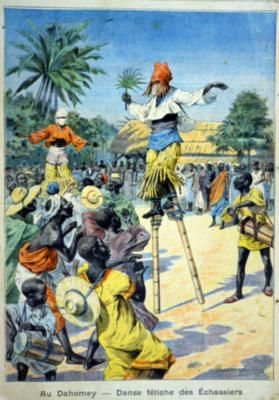 Caption translation: In Dahomey - Fetish Dance of the Stilt-Walkers.
