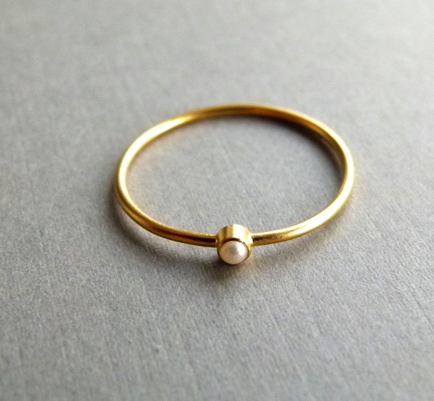 on bands gold ring wearing hands rings for or groom thin bee ideas wedding weddceremycom bride engagement thick band u