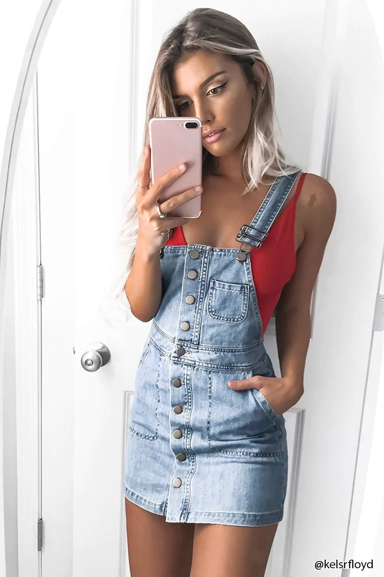 f451fb68bb6da1 Forever21 Contemporary - A denim overall dress featuring a buttoned placket,  adjustable shoulder straps,
