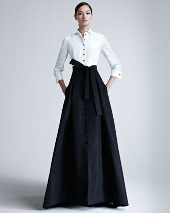 Carolina Herrera crafts an aristocratic prep school look in two-tone silk taffeta. Classically designed shirt adjoins feminine, A-line skirt. An archetypal bow ties self belt. The look is tailored, yet womanly. Style with canary diamond earrings for a surprising finish.