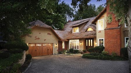 Fairytale cottage charm. Canyon Ridge Collection faux wood carriage house garage door. www.clopaydoor.com