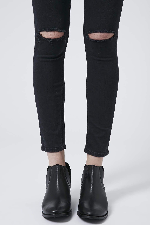 Ripped knee jeans es corte en la rodilla de los vaqueros
