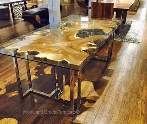 A Modern Dining Table Featuring A Solid Organic Asymmetrical Slab
