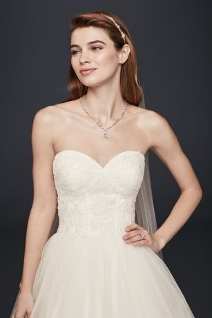 16479c0b3326 This strapless wedding dress is the perfect combination of demure and  alluring, with a shape-defining lace corset bodice, complete with seaming,  ...
