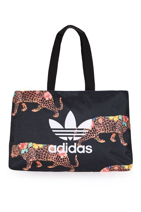 9b525abb4461 Adidas Originals  accessories are just as cool as their sportswear. This shopper  bag comes with a jaguar print and the iconic trefoil logo to the front.