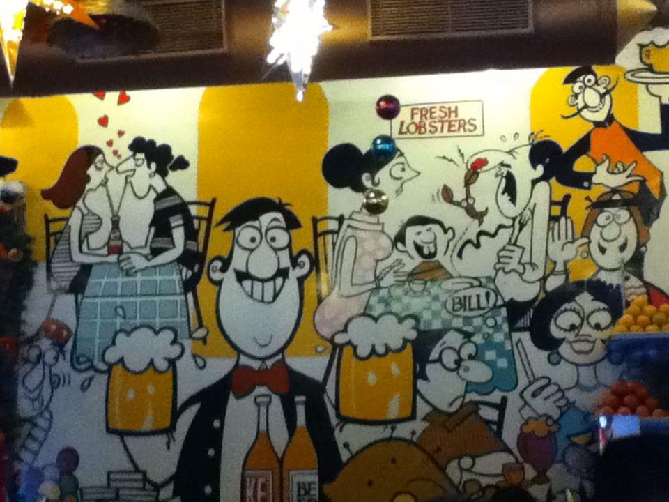 Wall Mural By Mario Miranda In Cafe Mondegar Mumbai All ABOARD - Wall decals mumbai