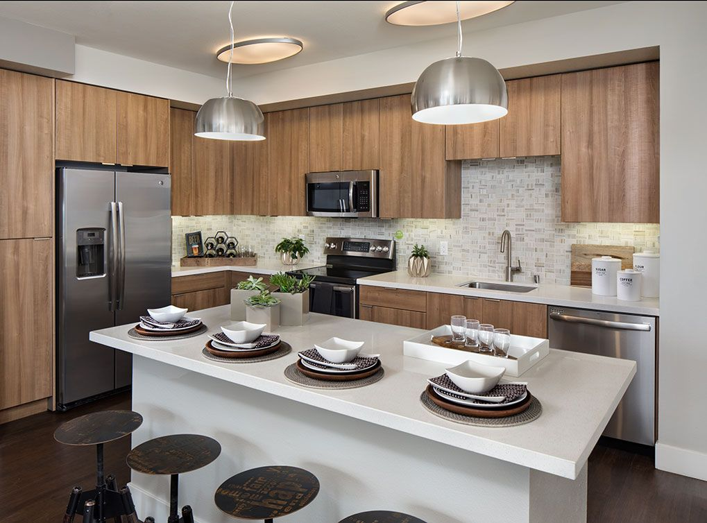 Light Wood Finishes Are Available In The Kitchens At The Amli Uptown Orange Apartment Community In Orang Looking For Apartments Apartment Apartment Communities