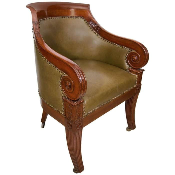 A Regency Leather Upholstered Mahogany Tub Chair With Boldly Scrolled Arm  Terminals And Reeded Sabre Legs