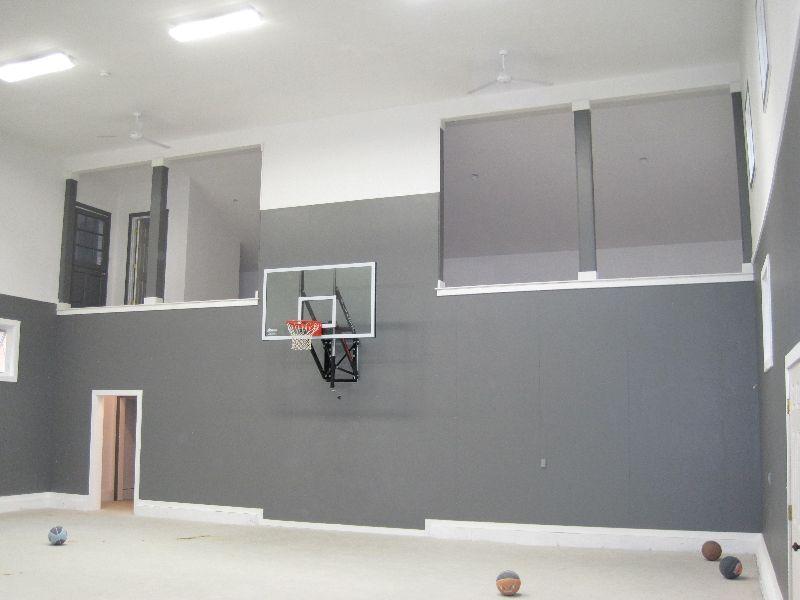 Basketball court inside garage garage indoor basketball for Indoor basketball court construction