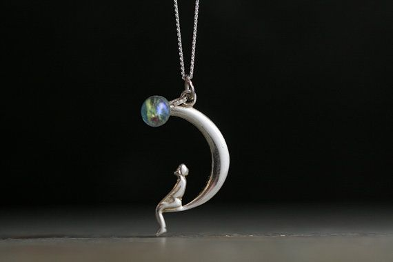 New: Sterling Man in Moon watching Earth by VillaSorgenfrei