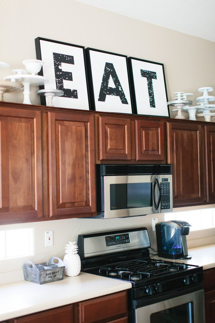 How To Decorate On Top Of Kitchen Cabinets Decorating Above