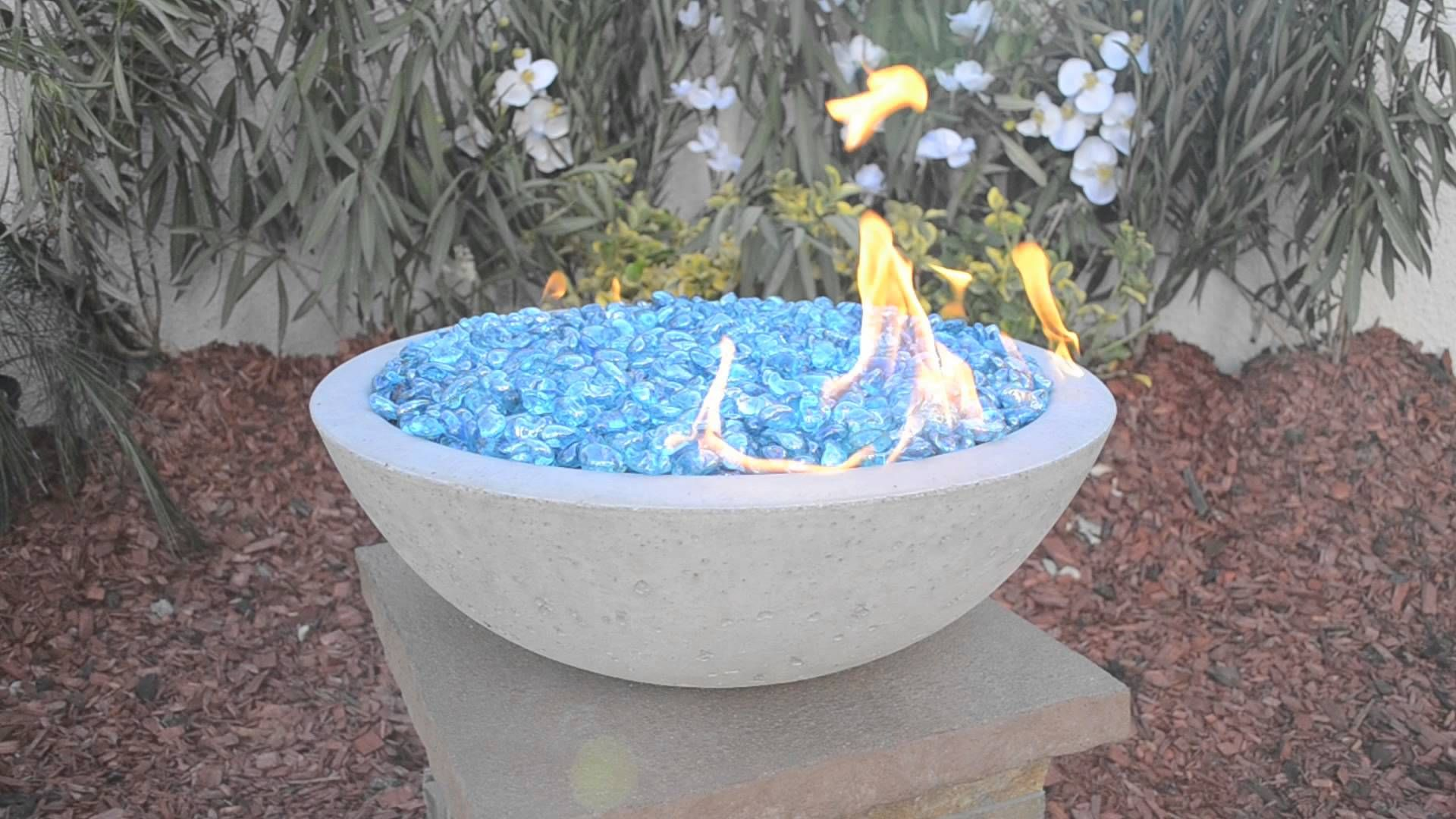 Concrete Fire Bowl. Grey Fire Bowl with Ice Blue Fire Beads.http://outdoorfireandpatio.com/