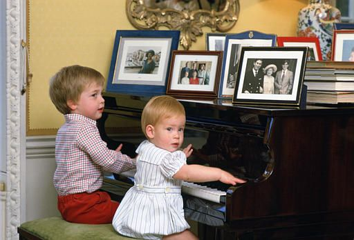 1985 William and Harry playing the piano