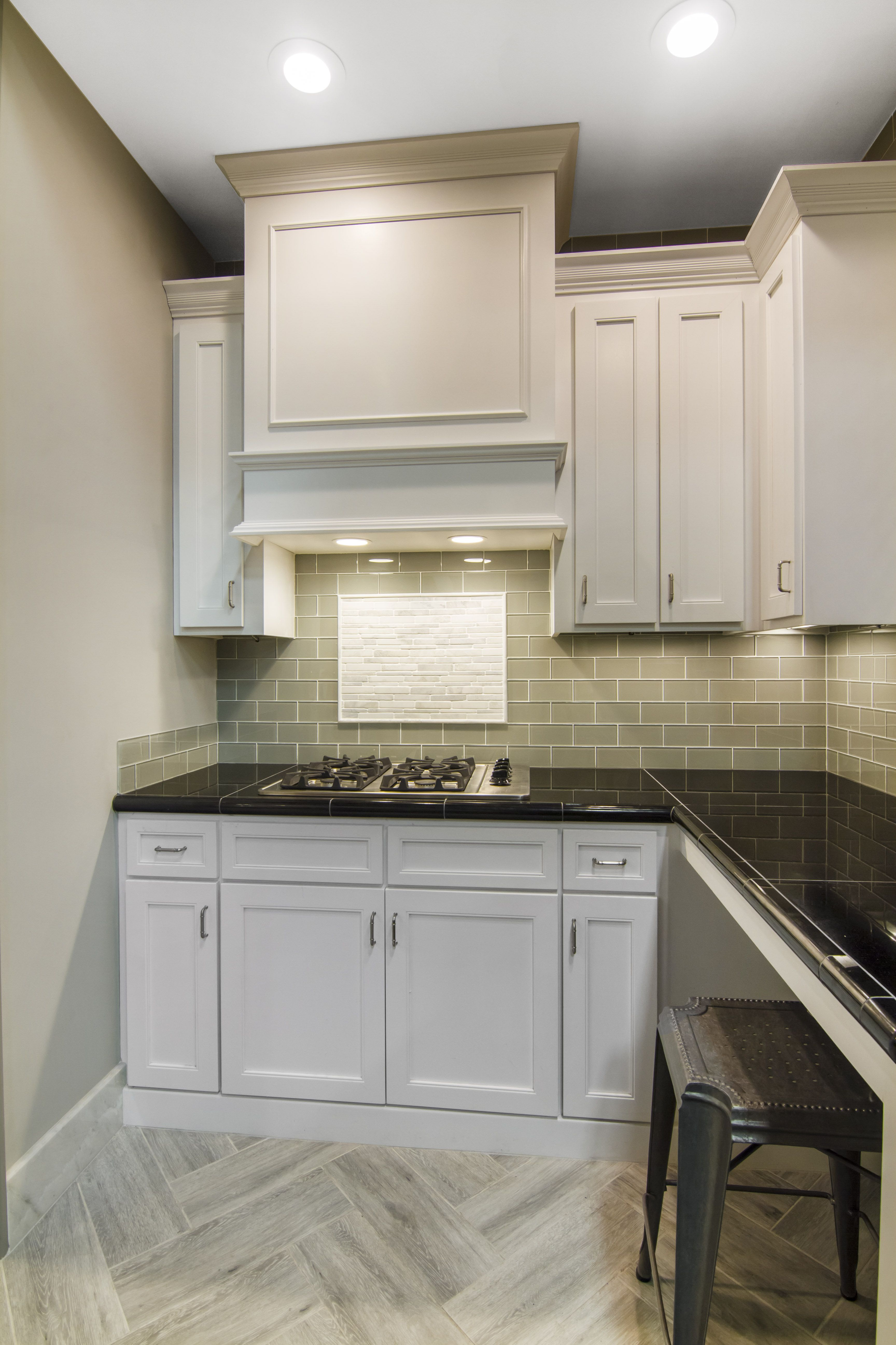 Glass Subway Tile With A Faux Wood Tile Herringbone Floor And Marble Mosaic Framed Accent Above Kitchen Remodel Layout Glass Backsplash Diy Kitchen Backsplash