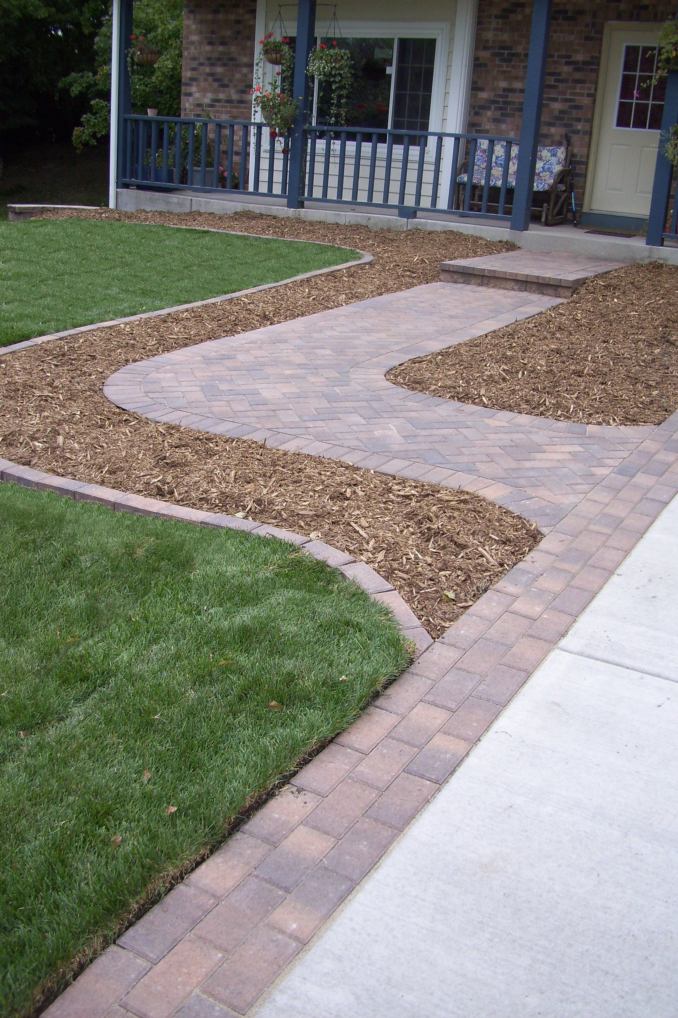 anchor holland paver walkway and border along driveway fieldstone