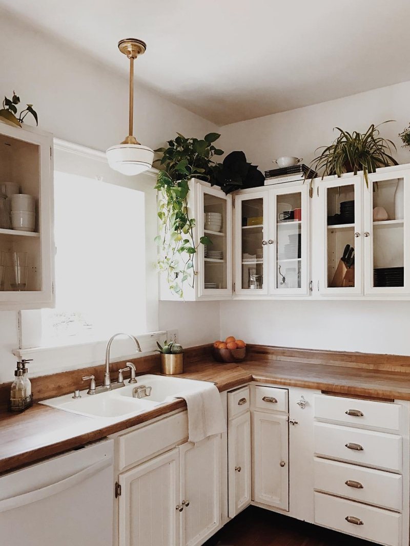 How Shanty Wijaya Doubled The Value Of A Los Angeles House Flip In 2020 Decorating Above Kitchen Cabinets Above Kitchen Cabinets Kitchen Cabinets Decor
