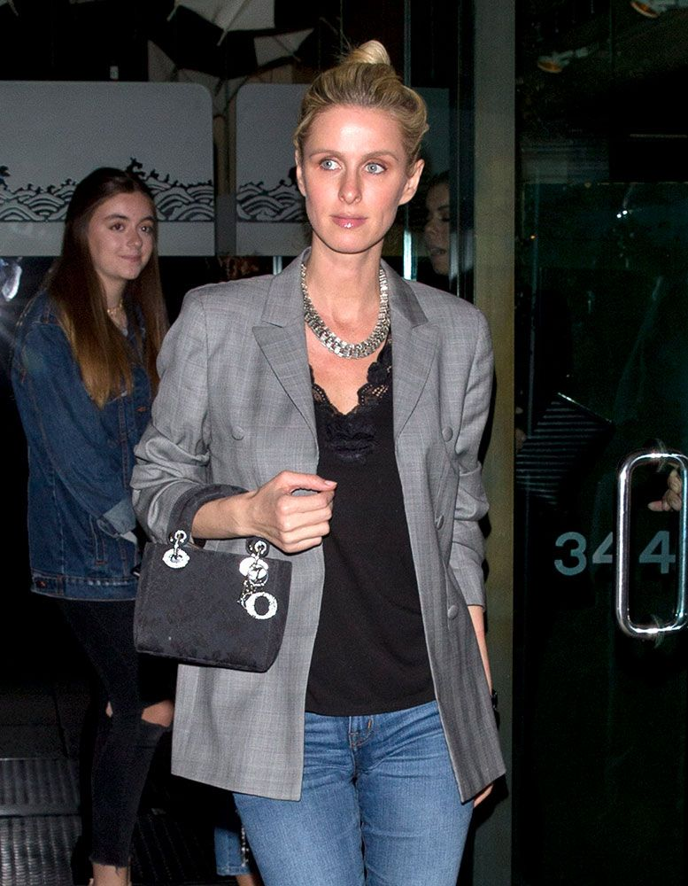 c4b665ac66951b Celebs Weather the Remainders of Winter with Black Bags from Prada, Miu Miu  and Alexander Wang