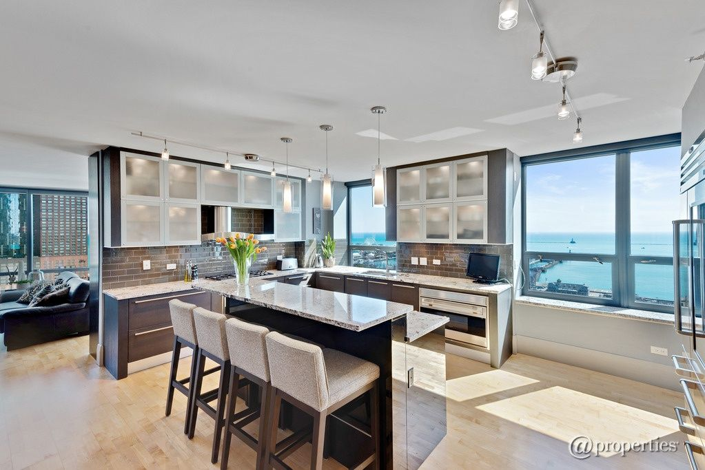 Contemporary Kitchen with Breakfast bar, Complex granite counters, U-shaped, flush light, Glass panel, Hardwood floors, Flush