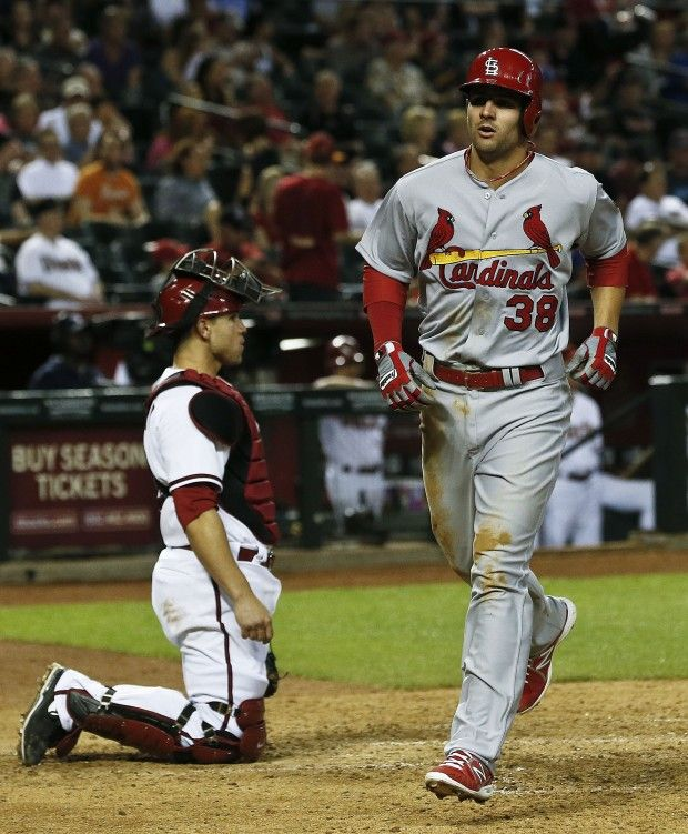 St. Louis Cardinals Pete Kozma (38) runs past Arizona Diamondbacks Miguel Montero after hitting a home run in the seventh inning during an MLB baseball game Tuesday, April 2, 2013, in Phoenix. (AP Photo/Ross D. Franklin)