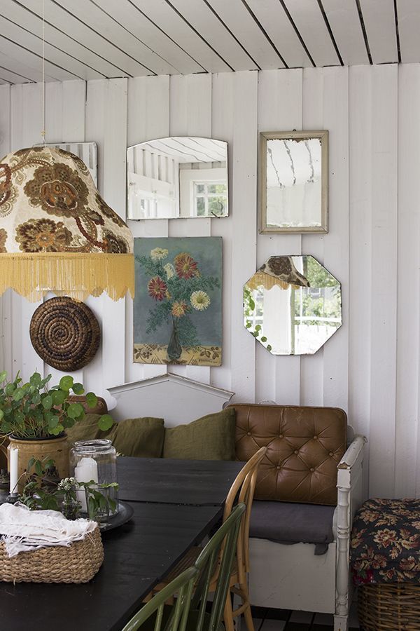 Electic farmhouse gallery wall and dining area