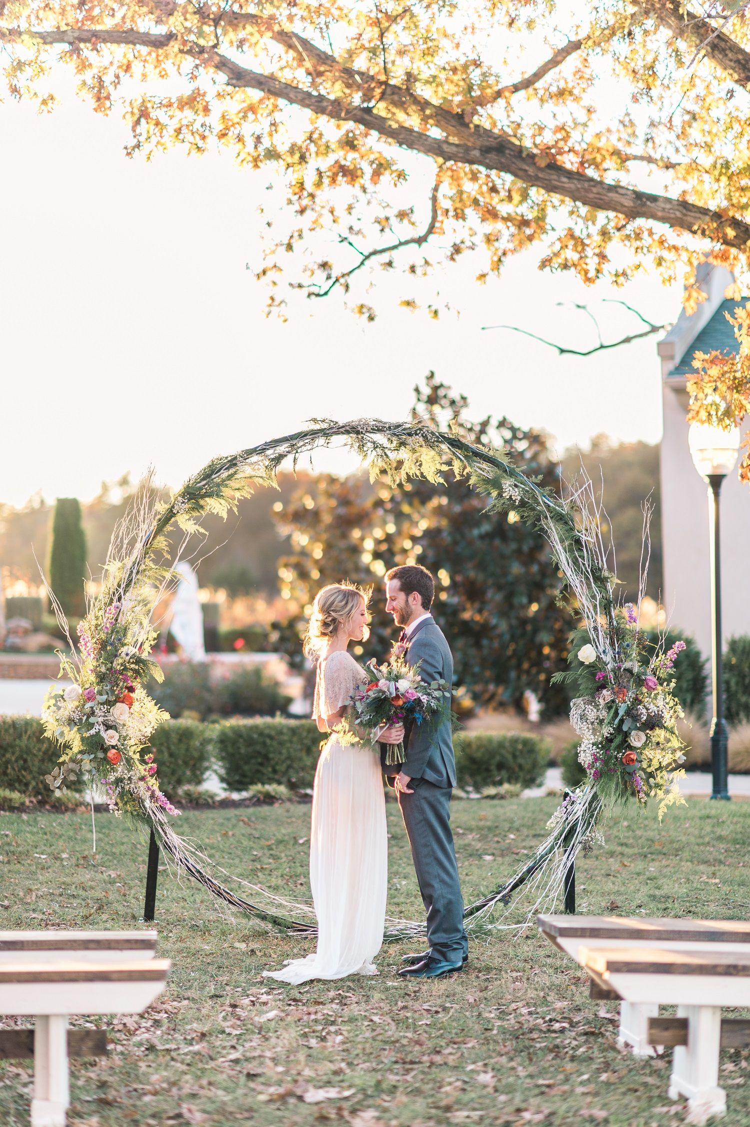 MSW Floral Hoop and Wooden Ceremony Benches at Morais