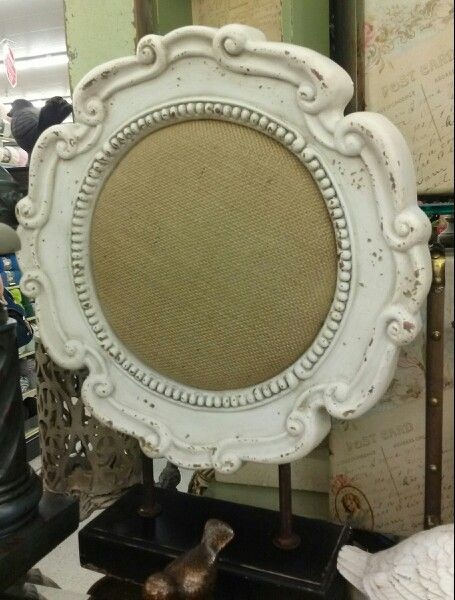 Loving the burlap inside the white antique frame. And the base to make it freestanding is a brilliant idea, too!